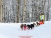 Kathernine Winrich on the trail passes Knik Hall after leaving the start at Knik Lakeat Knik during the start of the Junior Iditarod on Saturday February 25, 2017.    Photo by Jeff Schultz/SchultzPhoto.com  (C) 2017  ALL RIGHTS RESVERVED