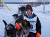 Ben Harper portrait with lead dogs at the finish line of the 2014 Jr. Iditarod Sled Dog Race at Happy Trails Kennel, Big Lake, Alaska Sunday February 23, 2014   Junior Iditarod Sled Dog Race 2014 PHOTO BY JEFF SCHULTZ/IDITARODPHOTOS.COM  USE ONLY WITH PERMISSION